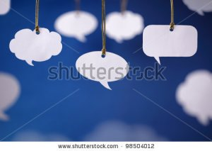stock-photo-blank-white-speech-bubbles-hanging-from-a-cord-98504012